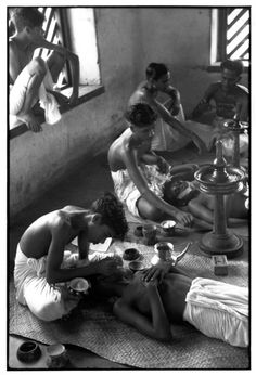 Henri Cartier-Bresson - INDIA. Kerala. Cheruthuruthi. 1950. Kathakali actors being made up for a performance from the Mahabharata.