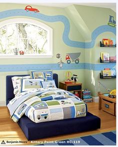 What a terrific bedroom! What little boy wouldn't enjoy being surrounded by cars, tractors and trucks? The blue green color pallet is perfect. The colors are warm and inviting. The green wall color is Kittery Point Green paint color by Benjamin Moore.