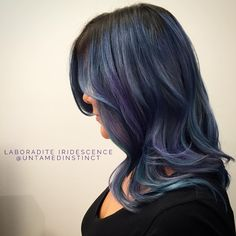 Laboradite Iridescence  Metallicized blue, lavender & teal tones create an #iridescent interplay of light and shadow. Refreshed with a gently, layered #drycut and #texturedwaves. x  Unleash your spirit and discover the transformative power of hair that tells your story. Get untamed!  #hair #haircolor #haircolorist #hairdresser #hairstylist #hollywood #losangeles #hairbrained #hairnerd #olaplex #iridescenthair #iridescentombre #metallichair #metallichaircolor #laboradite #iridescence…