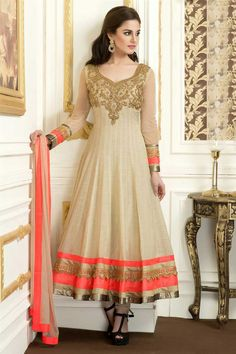 Beautiful beige cotton suit with kundan work: This suit in beige color is crafted in cotton material. Yoke portion engraved with thread, katdana and kundan work in lovely design. Bottom of the suit and sleeves are edged with shimmer border.