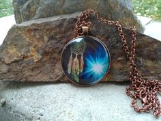 Check out this item in my Etsy shop https://www.etsy.com/listing/480230682/dreamcatcher-glass-pendant-necklace-15