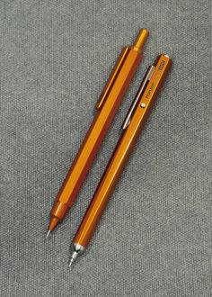 Orange Hexagonal: RHODIA scRipt mechanical pencil 0.5mm & OHTO Horizon needle-point pen NBP-587H.