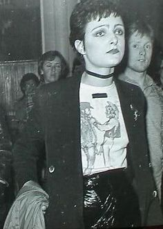 Siouxie Sioux wearing Two Cowboys t shirt. From Sex via Tom of Finland.