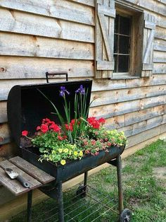 Old Charcoal Grill Repurposed Into Potting Bench Gardens