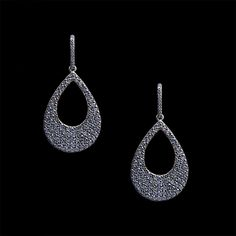 These beautiful sterling silver drop earrings feature over 150 light blue stones set in sterling silver.