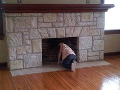 Cute photo of a little girl looking for Santa in the fireplace at my Open House!  804 Linden Dr , Jefferson City, MO 65109  $129,900
