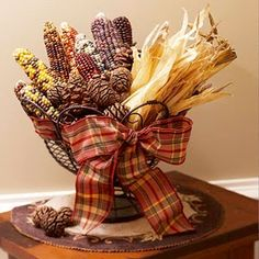 Create A Harvest Inspired Table Display By Filling A Basket With Indian Corn And Pine Cones