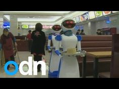 Restaurant in China hires robots as waiters - YouTube