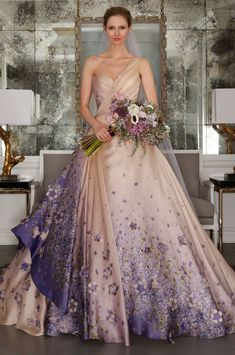 Make a grand entrance with this ombre ball gown dotted with 3D flowers.