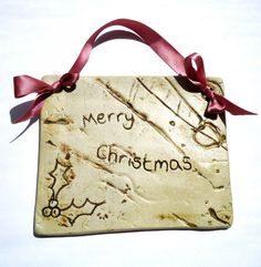 'merry christmas' ceramic plaque by Charlotte Hupfield Ceramics