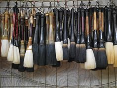 Calligraphy Brushes Hang On The Wall