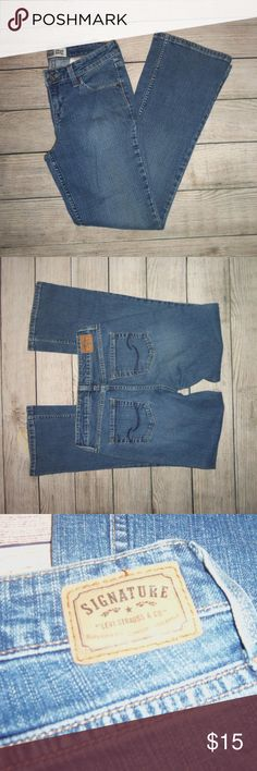 Signature Levi's Low Rise Boot Cut Jeans 4 these are a 4 medium. 99% cotton, 1 % spandex.  inseam is 30 inches  rise is 9 inches  waist laying flat is approx 15 inches. Levi's Jeans Boot Cut