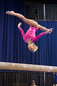 Nastia Liukin in flight gymnastics champion dancing with the stars pink balance beam suspended thin air