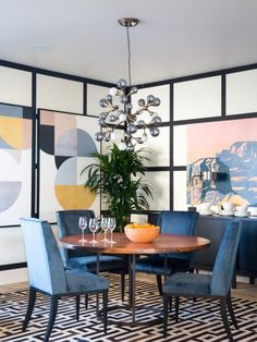 With a dramatic chandelier, modern art and white walls with black trim, the dazzling dining room offers a stylish space for sharing meals.