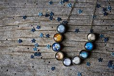 Solar System Necklace (3. Antique Bronze Tone with Pluto)... https://www.amazon.com/dp/B0139A6VH8/ref=cm_sw_r_pi_dp_x_A1sGybJSTD9TR