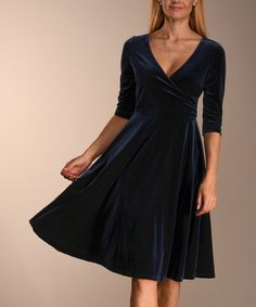 5132162a7235a Take a look at this Navy Velvet Surplice Dress - Women & Plus today!  Surplice