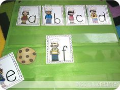"""Who Stole the Cookie? This is a fun whole group game to practice identifying letter names. Hide the cookie behind one of the letters and ask your students, """"Who stole the cookie from the cookie jar?"""" When they guess a letter, they pull it out of the pocket chart to see if they're right!"""