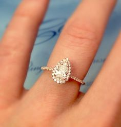 ac20a9991 Custom engagement ring featuring a pear shaped diamond in rose gold by  Coast Diamond. Available at Silverscape Designs!