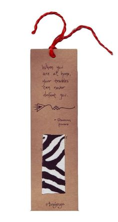 """Kitenge African Proverb Home Bookmark Kenya - This bookmark will hold your spot in your favorite book and makes a great gift for teachers. Bookmark made of recycled paper and up-cycled kitenge fabric swatches. Fabric colors and patterns vary. Ghanaian proverb reads: """"When you are at home, your troubles can never defeat you"""" A fair trade product from Kenya This bookmark was made by men of different ethnic groups who are working together to build strong homes, families, and communities. Your…"""