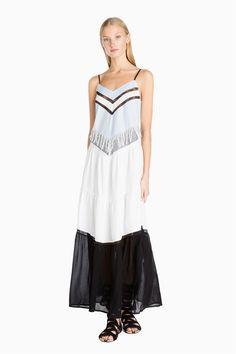 www.twinset.com es-ES vestido-largo-de-flecos-p9092?s=S&c=377