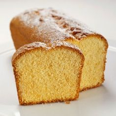 ginger and orange loaf cake with one slice removed to see the cake inside