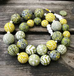 Polymer clay beads - Variety of pattern within a palette and repeated shape create a pleasing design.
