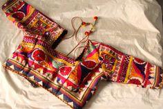 Gift to my divine pondaati b Ready made Kutch work blouse. Choli Blouse Design, Sari Blouse Designs, Fancy Blouse Designs, Garba Dress, Navratri Dress, Choli Dress, Kutch Work Saree, Work Sarees, Kutch Work Designs