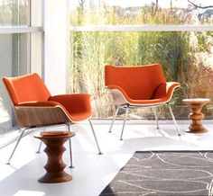 """This looks like a smart new generation of Eames reference chairs.  Always wondered what would make good occasional chairs in a setting with the Eames leather/ply recliner.  New Herman Miller """"Swoop"""" design by Brian Kane."""