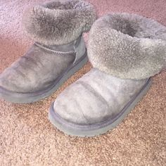 Uggs gray Bailey button These uggs have been worn for one season. They are in pretty good condition. They are a size 4 in kids which is equivalent to a women's size 5 1/2. ❗️FEEL FREE TO MAKE AN OFFER❗️ UGG Shoes Ankle Boots & Booties