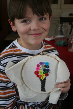 Teaching children how to sew a button in a fun way