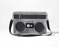 With this messenger-style Boombox Bag you will be able to fit in all the Pac-Man, Ray Bans, Members Only jackets, jelly bracelets, and 1980s nostalgia you want.