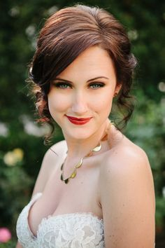 curly tendrils, photo by Katie Ruther http://ruffledblog.com/handcrafted-fall-wedding #bridal #hair #beauty