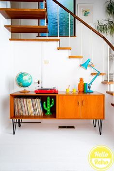 Mid Century G Plan E Gomme Teak Sideboard Record Storage Media filled with colourful accessories like an anglepoise lamp, orange pineapple, light up cactus and a big blue globe! Teak, Record Storage, Sideboard Media Console, Sideboard Record Storage, Home Decor, Interior Design Blog, Retro Furniture, Storage, Teak Chest