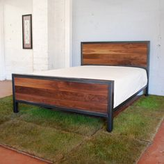 That is one sweet bed. Kraftig Bed Number 3 with Walnut. $1,400.00, via Etsy.
