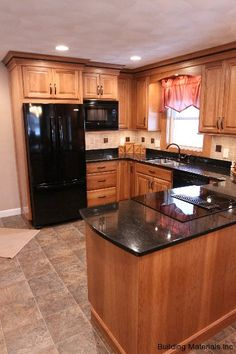 black counter; tile with accents back splash, stone floor