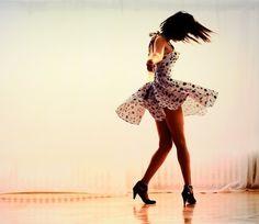 dancing. i love the polka dot dress!