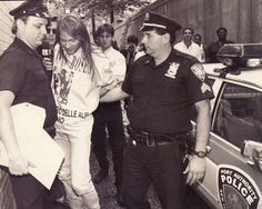 Axl Rose arrested in 1992.  Notice Kurt Loder from MTV News in the background?