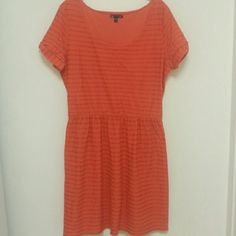 Gap Dress Gap orange dress size large. This piece is in good condition. There is only a little bit of aging from storage. There are horizontal stripes across the whole piece and a good structured waist line. The sleeve length is 7 inches. The shoulder to shoulder length is 16 inches. The whole piece is 38 inches long. GAP Dresses Midi