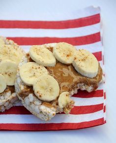 Healthy Snack Idea - Cover rice cakes in almond butter, add sliced banana and sprinkle with cinnamon. Yummy!