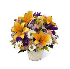 The FTD® Natural Wonders™ Bouquet. This garden basket is a display of the bright colors of nature. Arrangement includes lilies, iris, daisies and more.