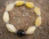 Yellow calcite gemstone with jet black Swarovski crystal focal stretch bracelet