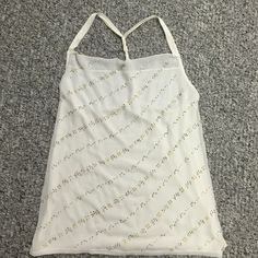 Express dressy tank Express dressy tank top. Size medium. Cream with gold beading. Cute twisted back. Worn once. In excellent condition. Some loose beading by the arm pit not very noticeable. Express Tops Tank Tops