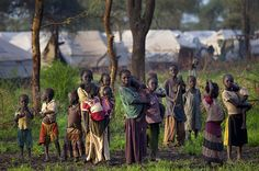 Before the age of nine percent of girls in South Sudan are wed; Sudanese refugee children are shown standing near tents in a muddy field on July 2012 in Jamam refugee camp Poverty Photography, Baby Carrying, Live News, Worlds Of Fun, New Image, The Guardian, Tents, Refugee Camps, Africa