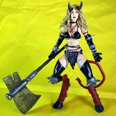 Darkchylde (Magik) (Marvel Legends) Custom Action Figure - Darkchylde is made from Hellcat's base. Head is Satanna and the goat- like legs was all sculpted from scratch. Some of the bracelets are from Monster High dolls and some was sculpted. Horns, hair, ax, breasts, and other minor details on costume was all sculpted.