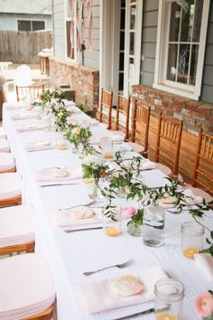 """Simple table--ruscus or other simply greenery + blooms of your choice  *could even get """"blown out"""" roses, etc. for a discount if the florist has some the day of or day before the party that they are about to throw away"""