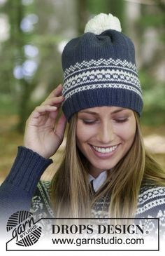 Hat with multi-coloured Norwegian pattern and pom pom. The piece is knitted in DROPS Lima.