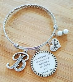 Welcome your future daughter in law into your family with this custom bracelet. You can surprise her at her bridal shower or on her wedding day. This bracelet is custom made to order. It features a twisted stainless steel adjustable bangle bracelet, that measures 60mm in size. It is