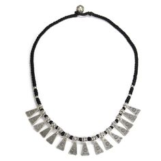This distinctive necklace showcases unique triangular shapes along with tribal beading. Each of the triangular pieces are etched with a sun symbol which signifies the Cycle of Life to the Karen tribe.
