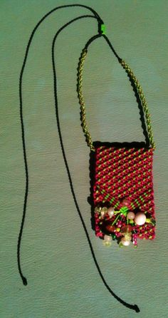 Micro macrame medicine pouch for the heart chakra. Took 6 hours to make. Hot pink and flouro green, with rosé quartz, pearl, mangano calcite, prehnite, clear quartz. AUD44