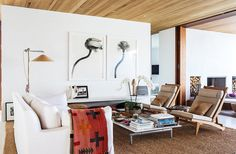 Outdoorsy piece including deck chairs and a sisal rug used indoors contribute to the house's easy-breezy feel.